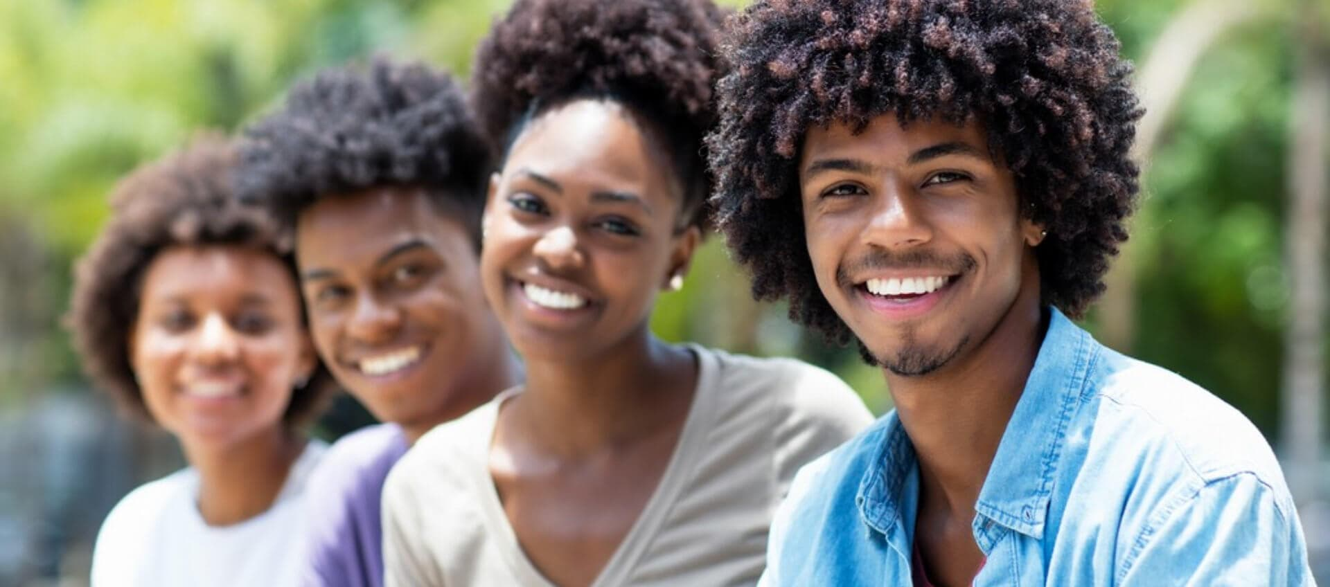 group of adult volunteers smiling concept